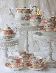 White Chandelier Pedestals topped with Royal Albert Lady Carlyle Tea Treasures from our Luxury High Tea Hire Collection… Vintage China, Vintage Tea, Vintage Table, Tea Cup Saucer, Tea Cups, Vintage Cake Stands, Teapots And Cups, Tea Service, Cake Plates