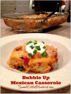 BUBBLE UP MEXICAN CASSEROLE!  Only five ingredients to make this delicious dish - chicken, refrigerator biscuits, enchilada sauce, Rotel (diced tomatoes and green chiles), topped with Mexican cheese blend. Simple to make, oh so good. | sweetlittlebluebird.com