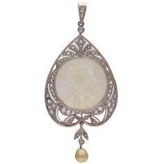 Antique Pearl Mother-of-Pearl Diamond Pendant. Gorgeous antique pendant, made in a graceful form. Set in platinum on top and 18K yellow gold on back. Mother-of-pearl carving of a beautiful Madonna.  Meticulous detail. Encrusted with rose diamonds and suspending a natural pearl. c 1905