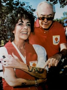 Elizabeth Taylor and Malcolm Forbes at a motorcycle rally in New Jersey, 1989.