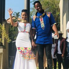 Image may contain: 3 people, people standing and outdoor African Wedding Attire, African Attire, African Wear, Long African Dresses, African Fashion Dresses, South African Traditional Dresses, Couples African Outfits, African Shirts, Moving Forward
