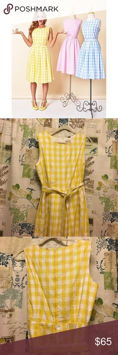 """Lindy Bop yellow gingham dress I only have the yellow one the model is wearing, not the two on the manikins. Gorgeous sunshine or lemon yellow lightly lined gingham dress in soft 100% cotton with pockets! Worn once, now too big for me! Belt is in the same material and removable; I like it better with a brown or white one. 43"""" inches in length, bust is 19"""" laying flat, 17"""" waist laying flat. Lindy Bop Dresses Midi"""