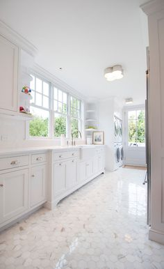 Elegant white laundry room with calcutta gold hexagon floor tile White Laundry Rooms, Mudroom Laundry Room, Laundry Room Layouts, Laundry Room Design, Laundry In Bathroom, Laundry Storage, Meme Design, Sweet Home, Up House
