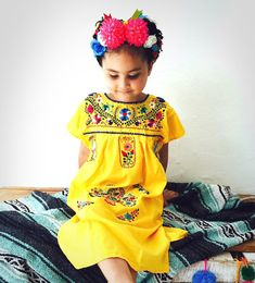 Girls Mexican embroidered summer dress in lemon yellow and delicate hand embroidery & trim keep it sweet on an empire-waist silhouette. The perfect piece for your little boho babe in training. Slip over. 100% cotton. Machine wash cold, tumble dry low. Not yellow? We have other colors
