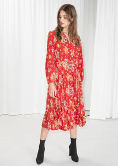Model front image of Stories floral pleated midi dress in red