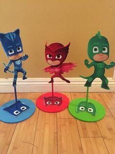 PJ Masks Inspired Centepiece, Catboy, Gekko, Owlette Birthday centerpieces, PJ masks party decorations by SOUTHFLOWER on Etsy https://www.etsy.com/listing/295161119/pj-masks-inspired-centepiece-catboy