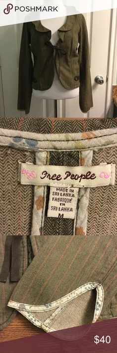 Free People denim blazer size medium Ruffle collar. Leather tie mid-chest. Leather trim. Floral trim at cuffs. Hook-and-eye closure mid-chest. Free People Jackets & Coats Blazers