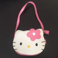Hello Kitty purse A small purse shaped like hello kitties face. Does zip closed and has pockets on the inside Hello Kitty Bags Baby Bags