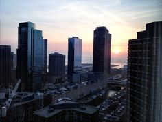 View from my club suite of Sunrise in Chicago; Why are upgrades always given when u r in at midnight out at 6am? (c) GTH & Marc Kassouf
