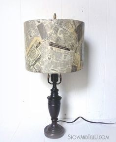 Old lamp shade is covered with newspaper and decoupage.  This look would work well in an ecclectic decor scheme. StowandTellU.com