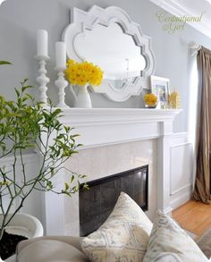 pretty mantle. love all the white and the grey wall. Add the yellow for a pop! so easy to change out for holidays also!