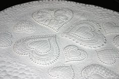 Sarah Vedeler embroidery designs done in all white with trapunto