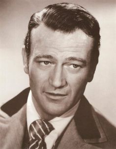 """...the classic John Wayne, """"i'm irresistible and you know it. now come over here and kiss me"""" smirk"""
