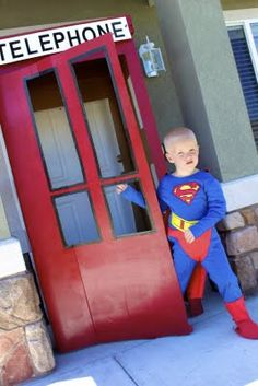 Super Hero Party Phone booth is a MUST this year ! LOVE this idea for the front door though !