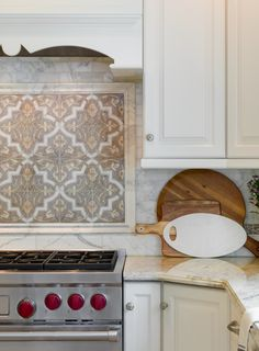 Close up look at this elegant kitchen backsplash on carrara marble.  Designed by Leedy Interiors of NJ and photographed by Paul S. Bartholomew of PA.