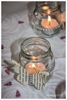 Tein ristiäisiin pöytäkoristeiksi mm. paperiperhosilla ja tekotimanteilla koristeltuja kynttilälyhtyjä.