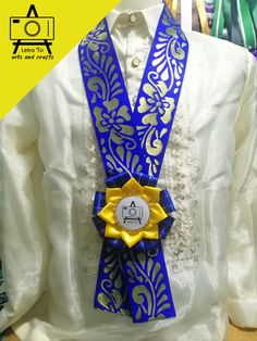 Elegant Rosette Lei for Delegates Materials: Organza Ribbon, Brocade Trimmings, Acrylic Button Pin, Double Edge Satin Ribbon Color: Gold, […] Graduation Leis, Lace Bracelet, Guest Speakers, Organza Ribbon, Dog Show, Flag Design, Ribbon Colors, Wooden Beads, Arts And Crafts
