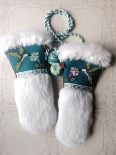 A Pair of Ladies Hummingbird Mitts that I made... Teal Melton, Czech seed beads, Vintage ribbon trim, White rabbit fur, and Moose hide (commercial) These are one of my faves for sure :) Carmen Dennis