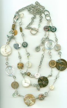 3 strand Button Necklace  (www.jodinobles.com)   How cool is this?   I love wiring buttons up like this, now why not make necklace stations and wire them together?   Have made charms and eardrops like this for years....here's taking it to the next level.   This piece is really well done.  LOVE!
