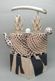 Beautiful unglazed teapot with sponged decoration and pineapple handle made by Roger Michel