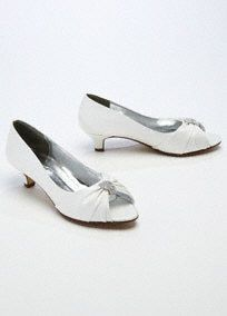 """Classic and very beautiful, this satin peep toe is perfect for any special ensemble!  Satin peep toe features sparkling crystal ornament.  Heel measures 1.5"""".  Available in Ivory.  Fully lined. Imported."""