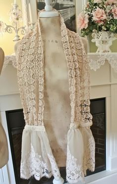 Shabby chic scarves made from bits and pieces of vintage table runners and lace.