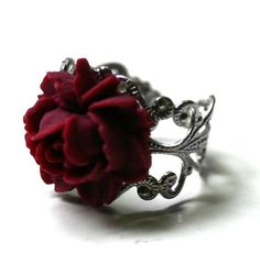 Rose ring--love. Very fairy tale-esque and a little gothic. Makes me think of Beauty and the Beast. You should check out the Etsy shop; there are lots of other gorgeous pieces.