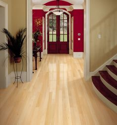 Natural maple entranceway by Mullican Flooring. www.mullicanflooring.com