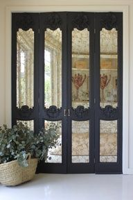 wonderful set of #mirrored #doors; love the black and mirror contrast.