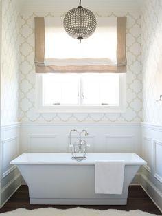 rectangular slipper tub with white wainscot surround