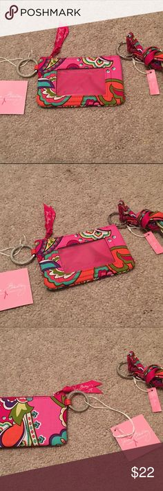Vera Bradley ID Case and Lanyard Pink Swirls NWT I am selling a matching set of Vera Bradley ID case and lanyard in Pink Swirls! These are brand new with tags! If you have any questions go ahead and ask away! I try to ship same or next day! Vera Bradley Accessories Key & Card Holders