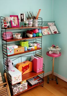 Craft room inspiration! Love the wall color and the very personal touch!