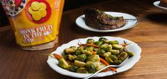 Ditch steamed peas and carrots. Toss Brussels sprouts and carrots with a lemony, garlicky mix.