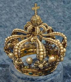 King Maximillian I of Bavaria had this one made for himself. It is famous for the dark Wittelsbach Diamond, which has been sold and stolen many times. A glass replica sits in its place now but the estimated value of the many pearls, rubies, emeralds, sapphires and diamonds is at $17 million