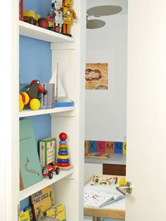 Enter Here - Even Julian's tiny entryway has a dual use: The Bouratoglous lined it with shallow shelves that hold toys and books.