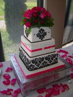 Fuschia & Damask Wedding Cake. falling in love with the damask print.