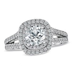 Brides.com: Engagement Rings with Pavé Settings. Style 18628313, Vera Wang LOVE 2 CT. T.W. diamond frame split shank engagement ring in 14K white gold, $9,499.99, Zales  See more round-cut engagement rings.