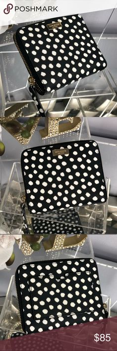 Kate Spade Darci Laurel Way Polka Dot Wallet Kate Spade Darci Laurel Way Polka Dot Wallet  Brand New...NWT Material: Saffiano textured  Print: musical dot  Color: Black and White  *Matching Bags Sold Separately in My Closet Bundle for Discount kate spade Bags Wallets