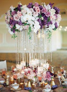 Photographer: Carmen Santorelli Photography; Glamorous purple and white flower wedding reception centerpiece;