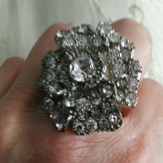 Ring Size 8 flower bling ring. Very pretty and in great condition. Jewelry Rings