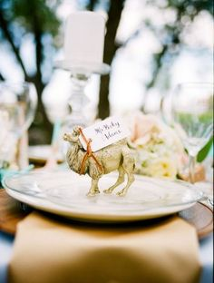Gold animal place cards settings.  Could use spray painted toys, ...
