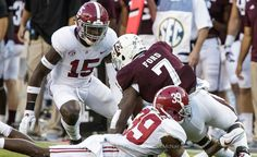 Harrison meet running back Ford head on in Bama win Saturday against the Aggies.