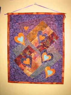 Art Quilt Fabric Wall Hanging Orange Purple Hearts by TahoeQuilts