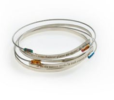 silver bracelets with Baudelaire verses
