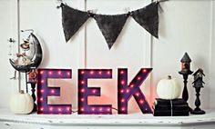 """For a bit of added flair on the porch, DIY this """"EEK"""" marquee sign."""