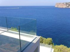 Frameless Glass Railing - if we're lucky we achieve something like this. The challenge is in the waterproof detailing at the connection