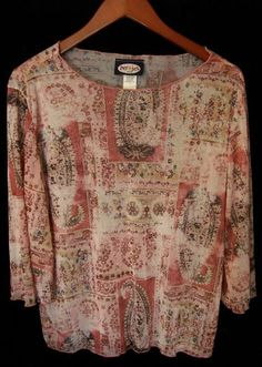 This is a gently worn Zoey Beth pink white tan green blue casual 3/4 sleeve plus 1X Women's Top Blouse. This top is sheer and meant to be worn over another top. It is so lightweight. The fabric has a beautiful abstract print with floral, and paisley. I couldn't imagine a more comfortable top with such style. You could put a belt with it. It could be worn with jeans or a skirt. With the right top under it, it could be worn as career wear.