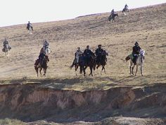 U.S. Special Operations, members of Task Force Dagger, and Afghani forces ride into northern Afghanistan in October 2001 on horseback.