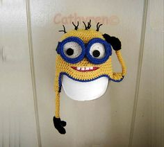 LOVE THIS! I bought this pattern.  Etsy listing at https://www.etsy.com/listing/158923184/despicable-me-minion-earflap-hat-beanie