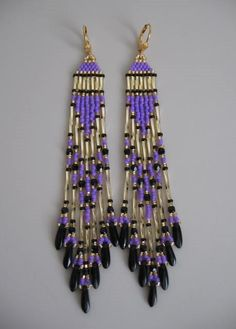 These pretty chandeliers are handmade with both 6mm & 12mm golden twist bugle beads, & golden, black, & opaque purple seed beads, with 3mm black fire